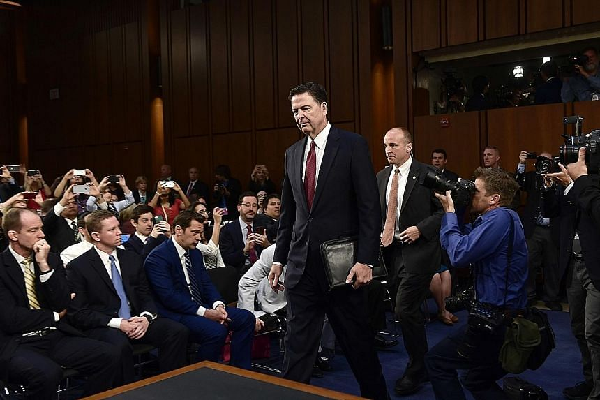 Mr James Comey was the consummate government man in his black suit and pristine white shirt with its barrel cuffs and point collar.