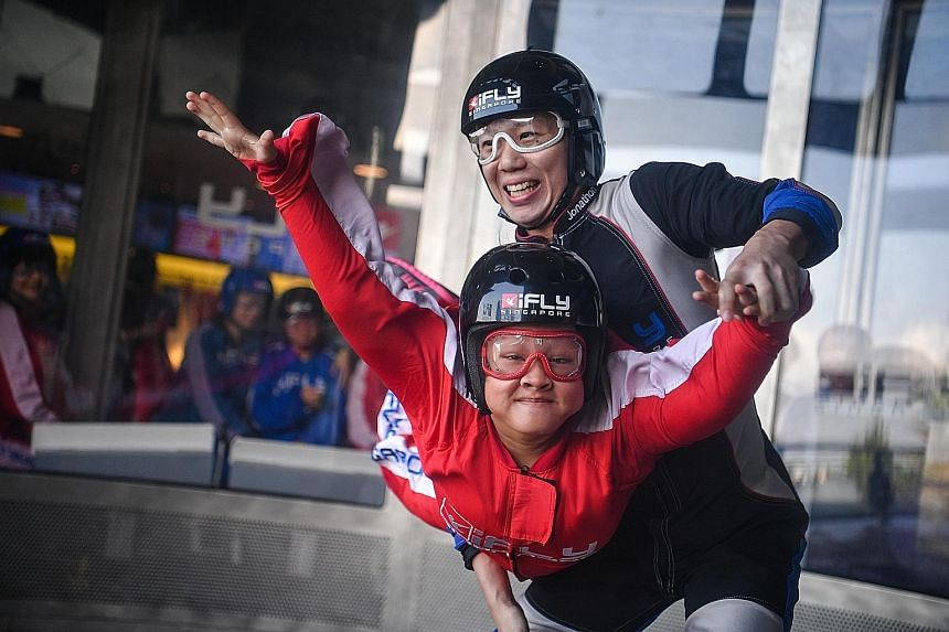 Natasha Lee Ann, 17, who suffers from Kabuki Syndrome, getting a taste of skydiving at iFly Singapore yesterday. She was among the participants of the Order of Malta Inaugural Asia Pacific Summer Camp who got a chance to try out the extreme sport. Th