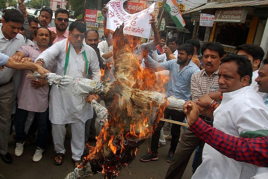 Demonstrators burning an effigy of Madhya Pradesh Chief Minister Shivraj Singh Chouhan at a protest organised by the opposition Congress party in the state capital of Bhopal on Wednesday.