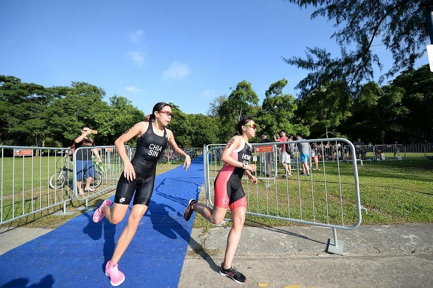 Winona Howe (right) and Denise Chia racing during the SEA Games triathlon selection trial in January. They were the top two finishers and were nominated to compete at the Aug 19-30 Kuala Lumpur Games but Howe could miss out.