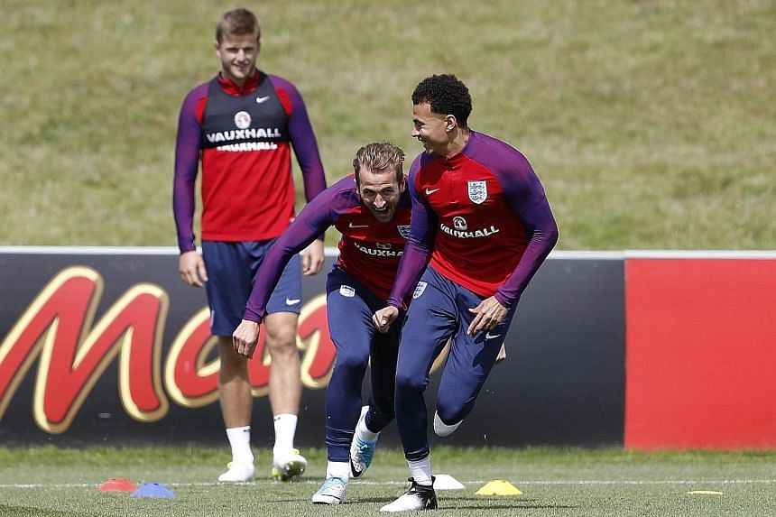 England's Harry Kane having a lighter moment with club team-mate Dele Alli (right) ahead of today's World Cup qualifier against old foes Scotland. The England striker, coming off a second season in which he won the Premier League's Golden Boot, will