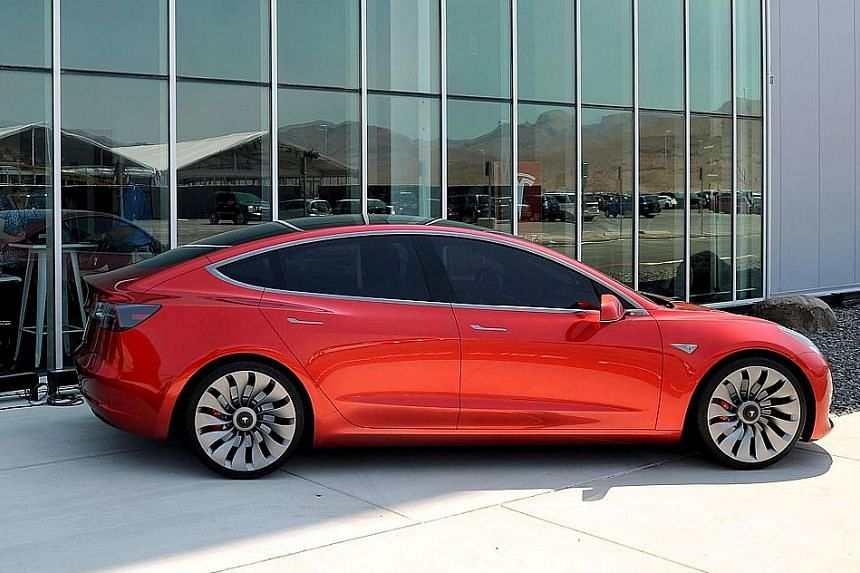 Tesla Model 3 customers can choose the car's colour and size of its wheels and eventually choose between two motors - one designed for highway travel and another for stop-and-go traffic.