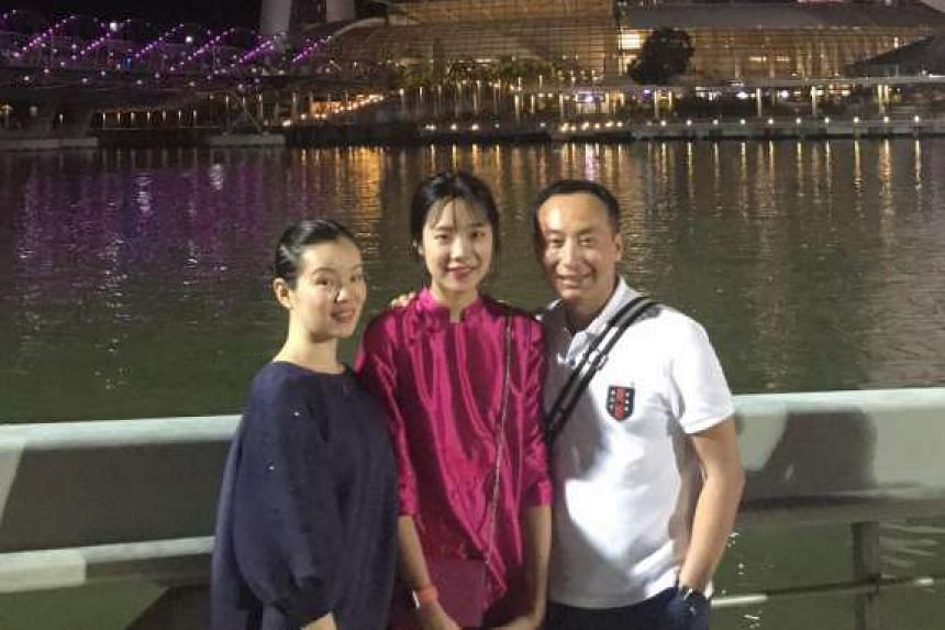 Mr Zhang Yitian with his wife Cheng Qi and daughter Zhang Jiasi in Singapore during Chinese New Year this year.