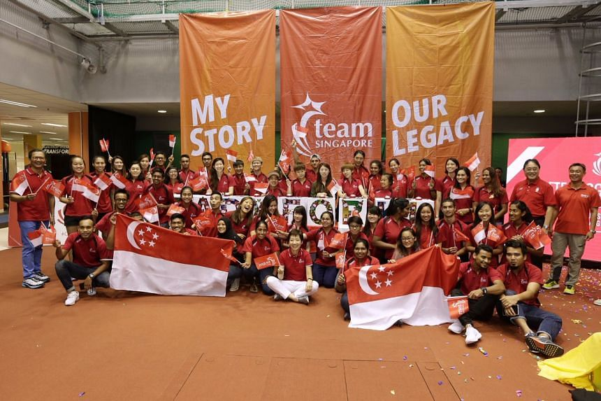 Minister for Culture, Community and Youth Grace Fu posing for a photo with national athletes at the Singapore Sports Institute.