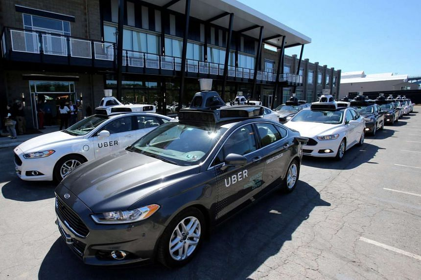 A fleet of Uber's Ford Fusion self driving cars are shown during a demonstration of self-driving automotive technology in Pittsburgh, Pennsylvania, US, on Sept 13, 2016.