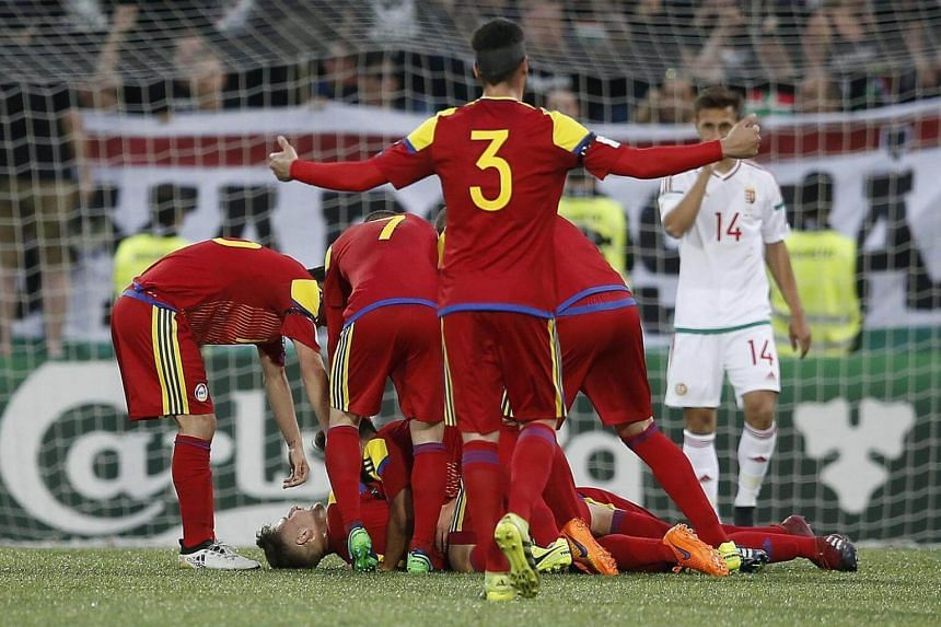 Andorra's player Marc Rebes (centre) celebrates after scoring a goal during the Fifa Russia 2018 World Cup qualifying round soccer match between Andorra and Hungary in Andorra city, Andorra on June 9, 2017.