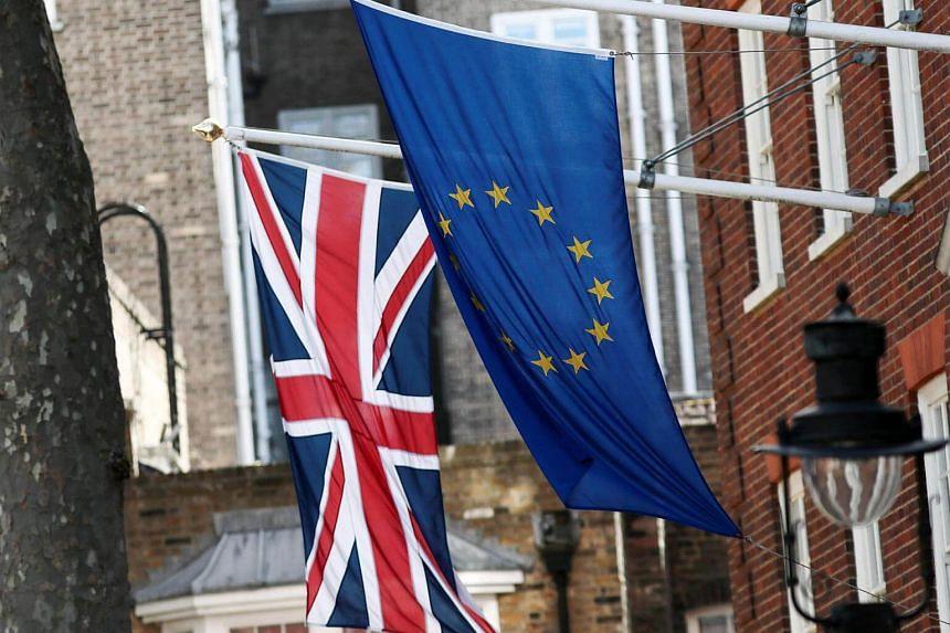 The Union flag flies next to a European Union (EU) flag outside Europa House in London, UK.
