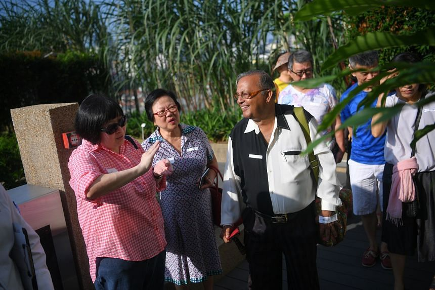 Life editor Tan Hsueh Yun (far left) speaks to a participant during a tour of the rooftop farm as part of the Farm-to-Table event at One Farrer Hotel and Spa for ST subscribers on June 10, 2017.