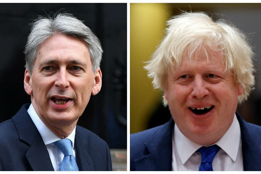 Finance minister Philip Hammond (left) and foreign secretary Boris Johnson will stay in place.