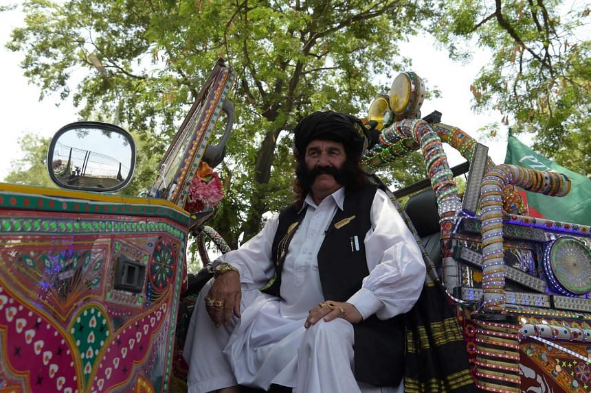 Pakistani man Mastan Khan Wazir, 70, who has 22 children from his three wives, sits in his blinged-out jeep, on May 19, 2017.