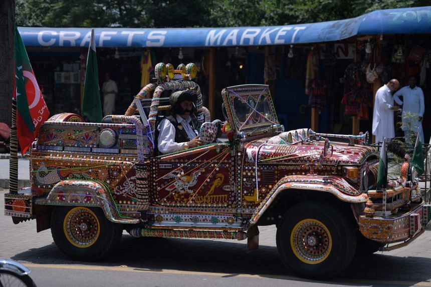 Pakistani man Mastan Khan Wazir (centre), drives his blinged-out jeep in Islamabad, on May 19, 2017.