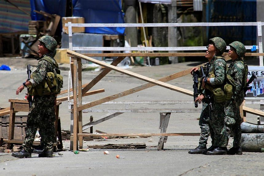 Government soldiers watching an air strike as troops from the government carry the continuous assault with insurgents from the so-called Maute group, who has taken over large parts of the Marawi City, Philippines.