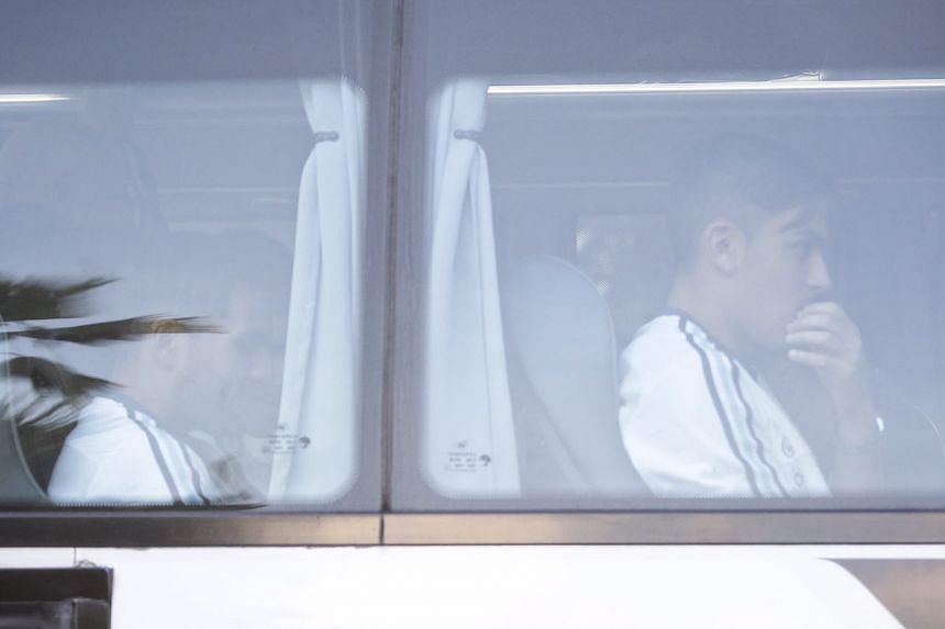 Juventus and Argentina forward Paulo Dybala (right) seen on the team bus leaving CIP Terminal after arriving in Singapore on June 10, 2017.