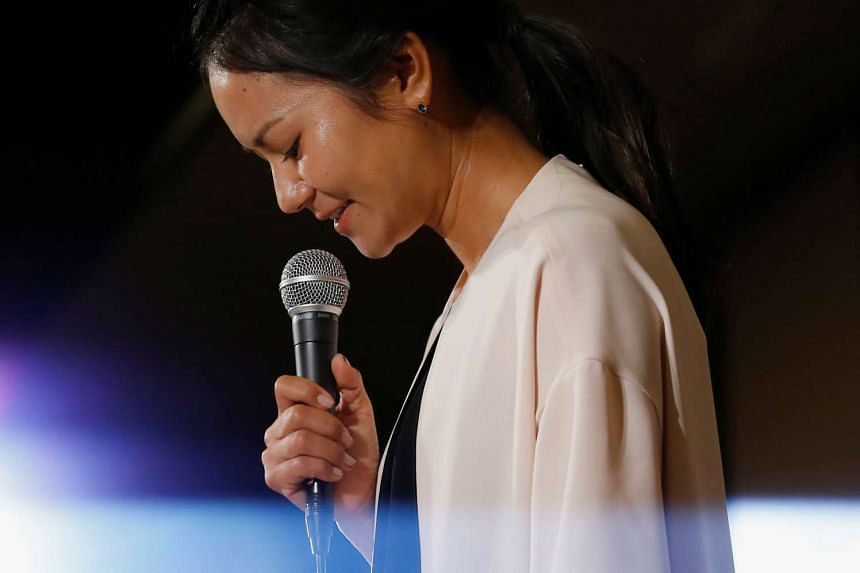 Former women's world number one golfer Ai Miyazato reacts as she attends a news conference to announce her retirement in Tokyo, on May 29, 2017.