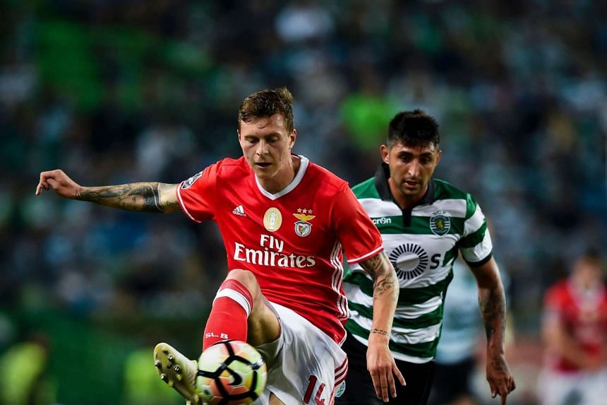 Benfica's Victor Lindelof (left) is joining Manchester United.