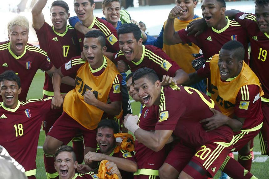 Venezuelan players celebrate at the end of their U-20 World Cup quarter-final match against the US.