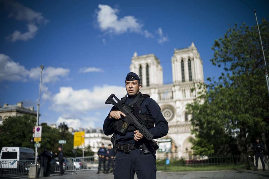 A French police officer stands guard outside Notre Dame cathedral, June 6, 2017.