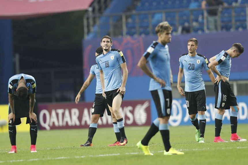 Uruguay players react after losing their semi-final match against Venezuela.