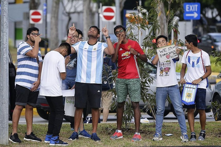 Fans (top) waiting outside Changi Airport's JetQuay CIP terminal hoping to catch Messi and his teammates, including Angel Di Maria (foreground) and Nahuel Guzman.
