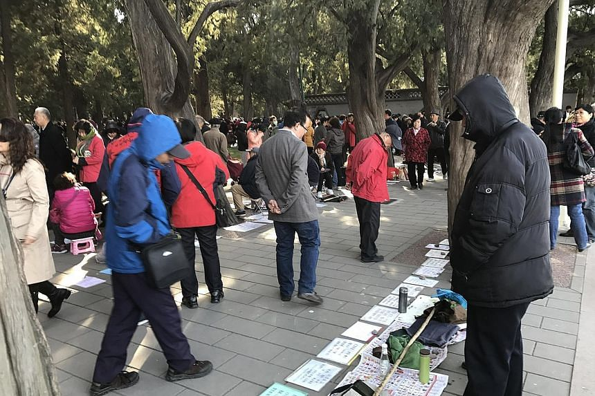 """In China, it is common for singles to find a spouse through commercial dating services, """"marriage markets"""" like this one in Zhongshan Park in Beijing, or reality TV shows. Now they have another option: The Communist Youth League is stepping in to hel"""