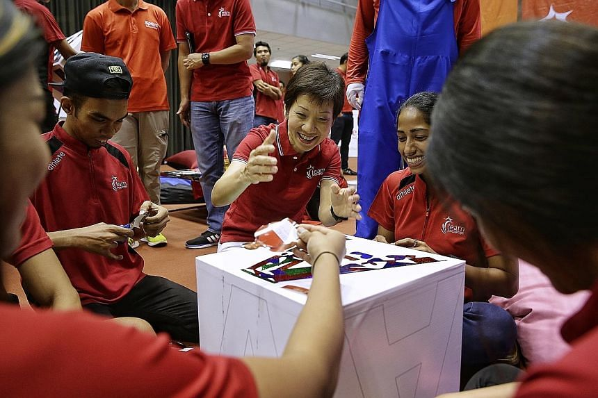 """Minister for Culture, Community and Youth Grace Fu joining national women's cricket captain G. K. Diviya and cerebral palsy footballer Muhd Firdaus Mohd Noor at the launch of the """"#OneTeamSG Ready for KL"""" campaign to rally local support for the KL SE"""