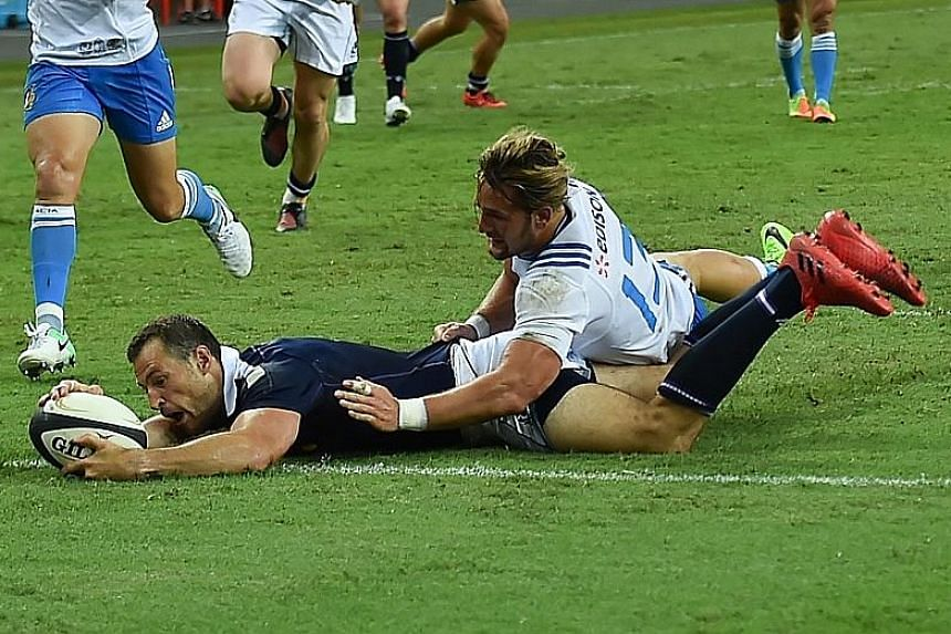 Scotland winger Tim Visser scoring a try against Italy, one of five the Scots made at the National Stadium, along with three conversions and a penalty.
