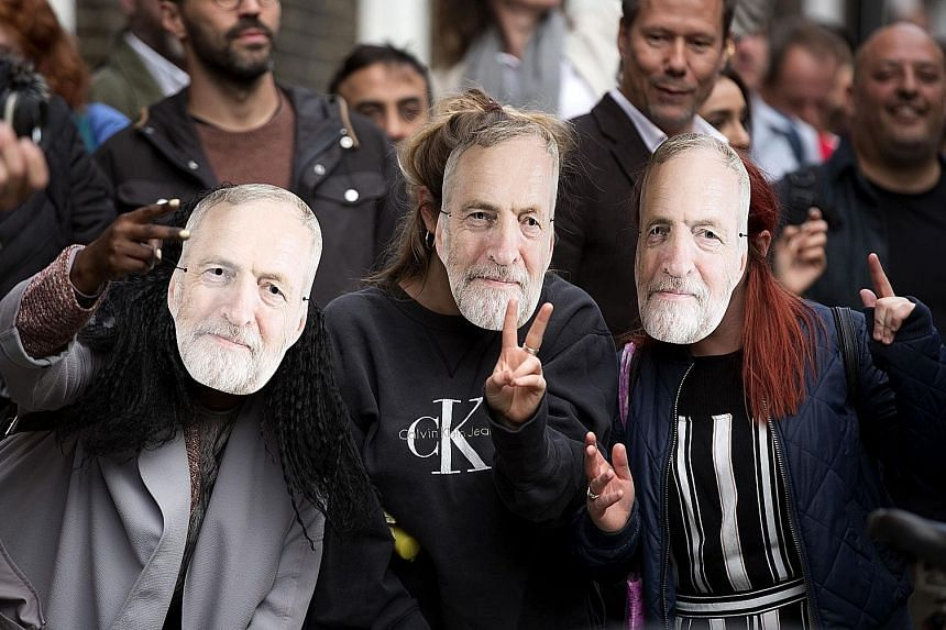 Supporters of Labour leader Jeremy Corbyn wear their allegiance proudly.