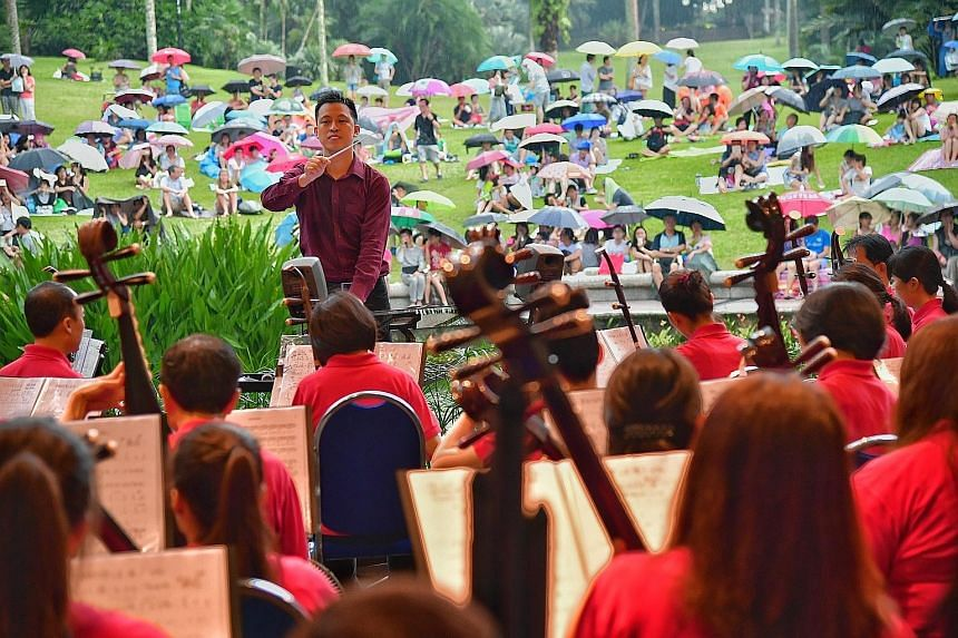 Visitors to the Singapore Botanic Gardens were treated to performances by the Singapore Chinese Orchestra (SCO) yesterday evening. Led by its conducting fellow Adrian Tan (left), the orchestra performed the Super Mario Theme Medley. Under the baton o