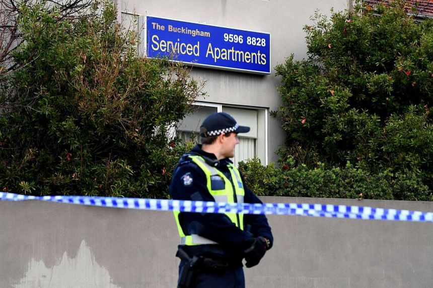 A police officer stands guard outside the Buckingham Serviced Apartments in Brighton in Melbourne on June 6, 2017, after police shot dead gunman Yacqub Khayre after he held a woman hostage.