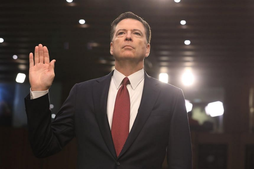 Former FBI Director James Comey is sworn in before he delivers his testimony before the Senate Intelligence Committee, on June 8, 2017.