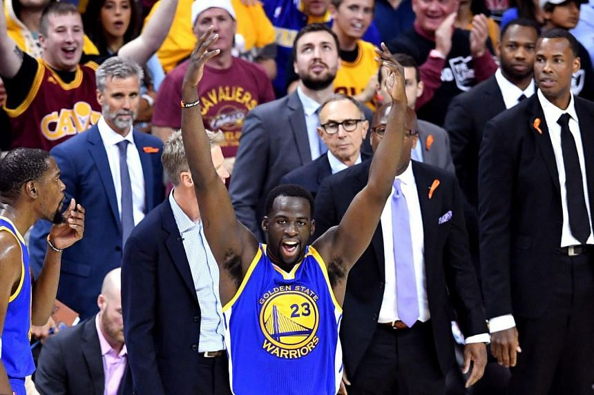 Draymond Green gestures to the crowd after a foul in the third quarter against the Cleveland Cavaliers at Quicken Loans Arena on June 9, 2017.