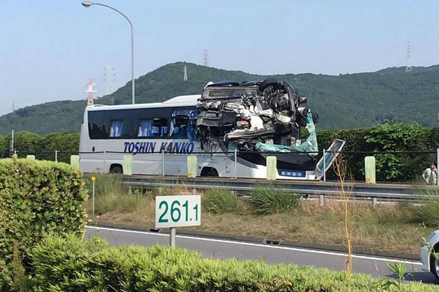 The damaged bus after a passenger car crashed into it on the Tomei Expressway in Shinshiro, Aichi Prefecture on June 10, 2017.