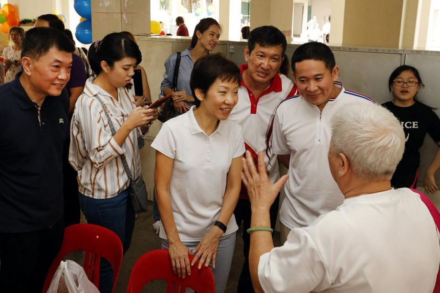 Ms Grace Fu (centre), Minister for Culture, Community and Youth and Grassroots Adviser Amrin Amin (to her left) visiting the Woodlands Constituency on June 11, 2017.