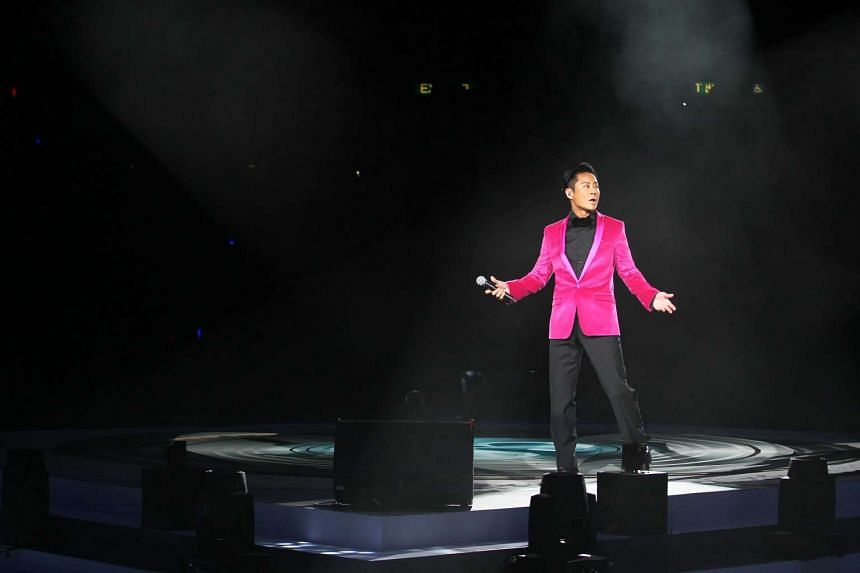 Grasshopper singer Remus Choy standing near the site of the accident in the Hong Kong Coliseum and singing solo on Friday (June 9).