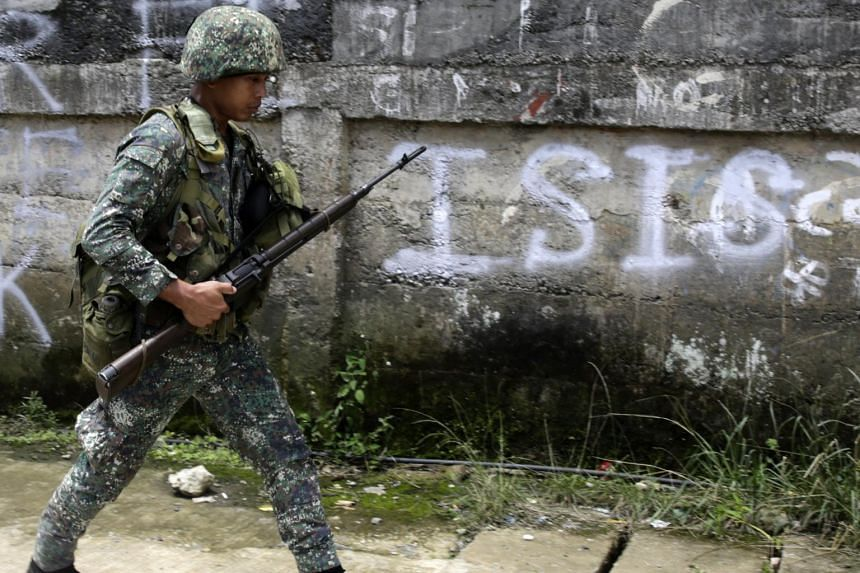 A Filipino government soldier walks on a street as fighting between Islamist militants and government forces continues in Marawi City, on June 2, 2017.