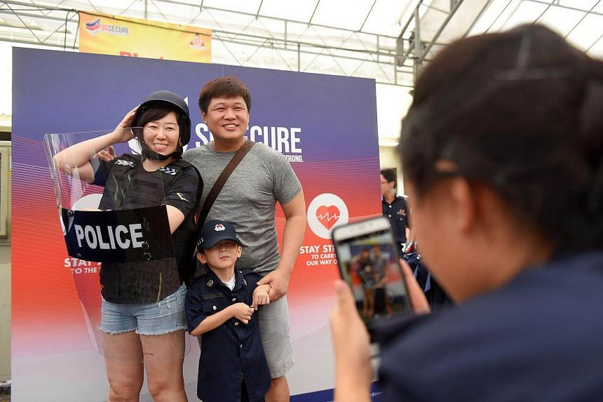 Married couple and Kolam Ayer residents Yiwei Sun and Wallace Neo, both 33, pose for a photo with their 4-year-old son Logan Neo.