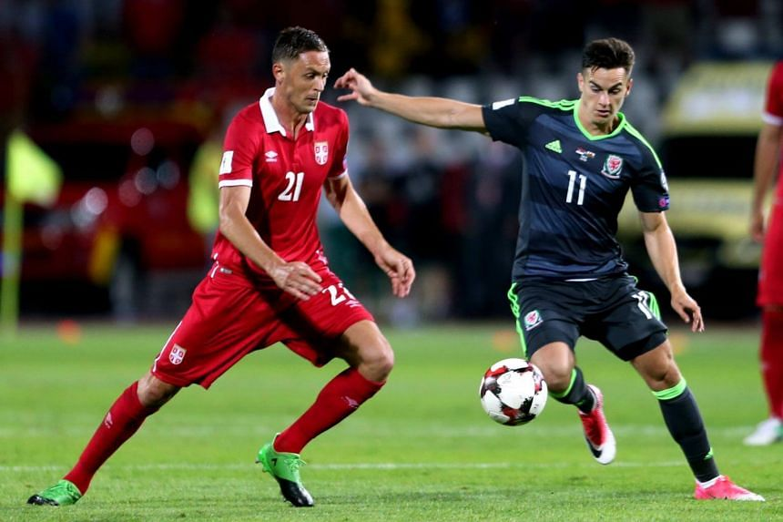 Tom Lawrence (right) of Wales in action against Nemanja Matic (left) of Serbia during their Fifa World Cup 2018 qualifying soccer match between Serbia and Wales in Belgrade, Serbia, on June 11, 2017.