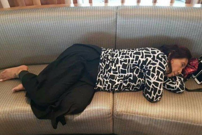 Indonesian Maritime and Fisheries Minister Susi Pudjiastuti was seen sleeping on a couch at John F. Kennedy Airport in New York.