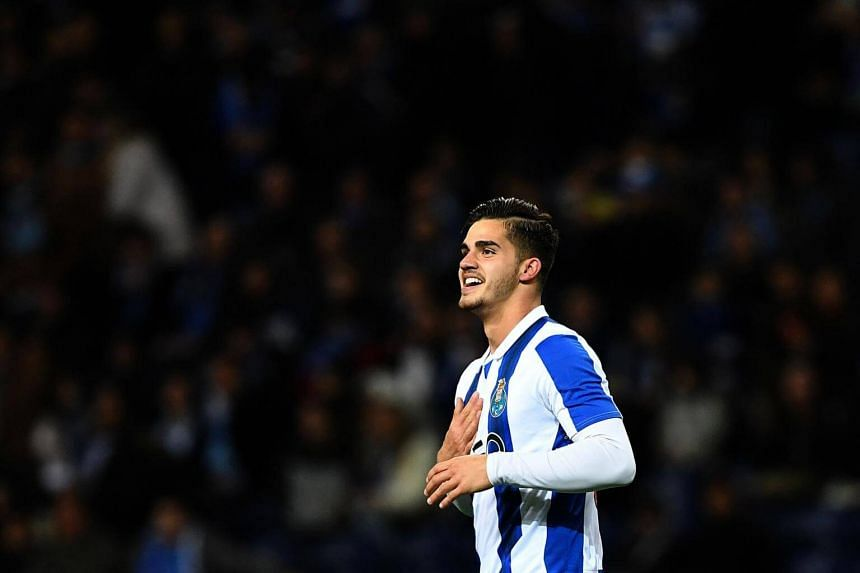 Porto's forward Andre Silva celebrates after scoring a goal during the Portuguese league football match FC Porto vs CD Nacional Funchal at the Dragao stadium in Porto on March 4, 2017.