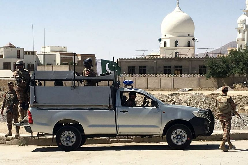 Pakistani security officials inspect the area from where two Chinese nationals were abducted by unknown armed men, in Quetta, the provincial capital of restive Balochistan province, Pakistan, May 24, 2017.