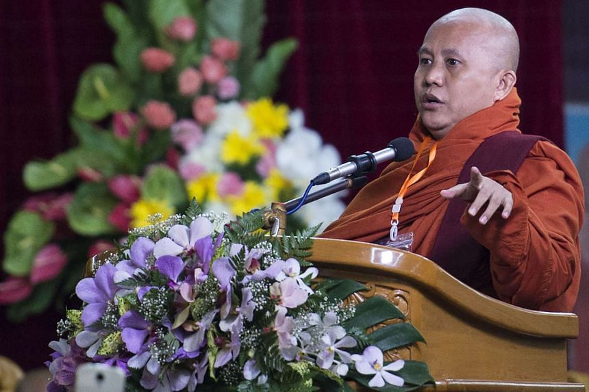 Myanmar hardline Buddist monk Wirathu speaks during a meeting in Yangon on May 27, 2017.