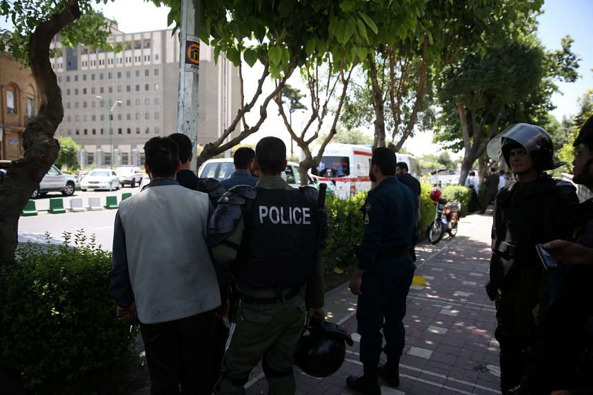 Iranian police stand near the parliament's building during a gunmen attack in central Tehran, Iran, June 7, 2017.