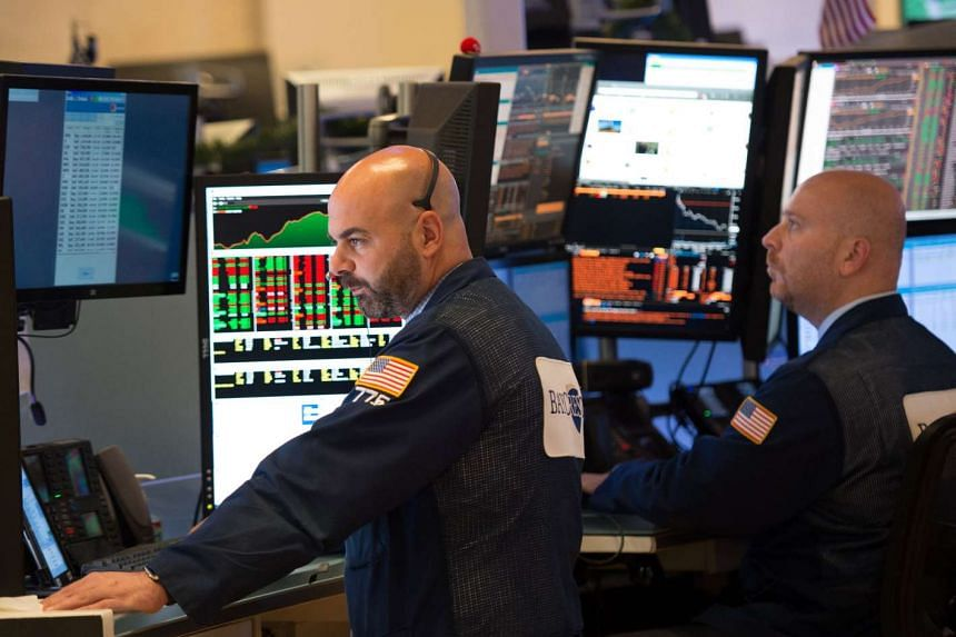 Traders work on the floor of the New York Stock Exchange at the closing bell of the Dow Jones Industrial Average on June 8, 2017 in New York.