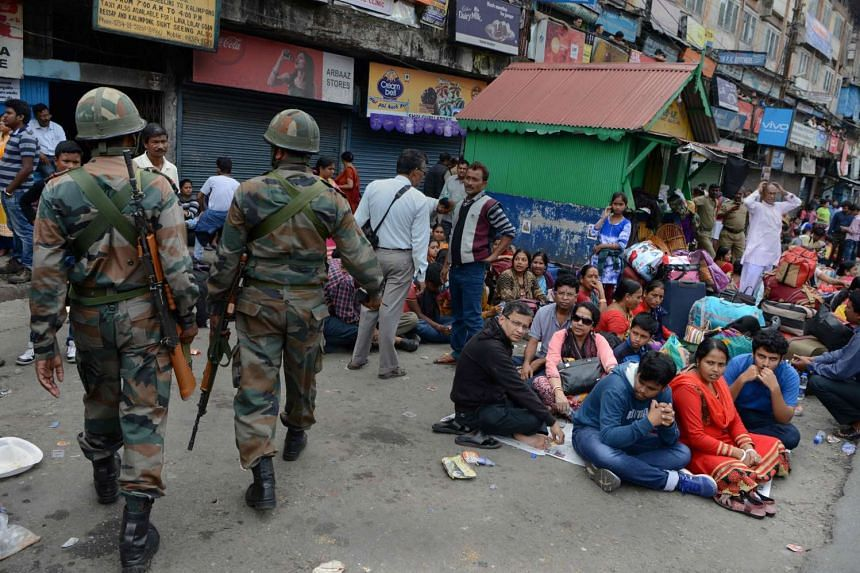 Indian Army personnel patrol following clashes between police and protesters supporting the Gorkha People's Liberation Front (GJMM) in Darjeeling on June 9, 2017.