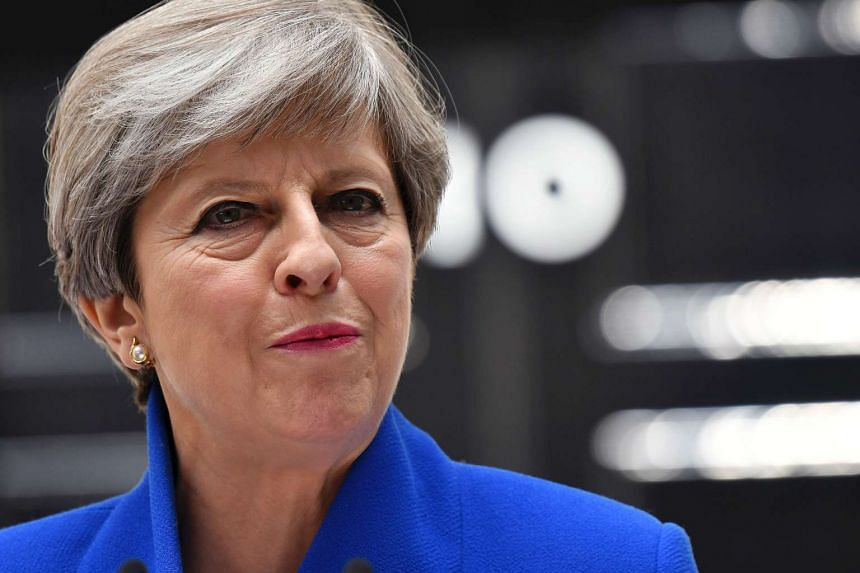 Britain's Prime Minister and leader of the Conservative Party Theresa May delivers a statement outside 10 Downing Street in central London on June 9, 2017.