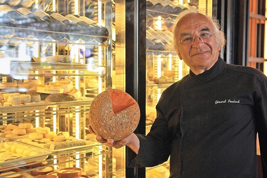 Cheese master Gerard Poulard holding a block of Mimolette, one of 50 varieties of cheeses he brought for a showcase at Ginett Restaurant & Wine Bar in Hotel G.