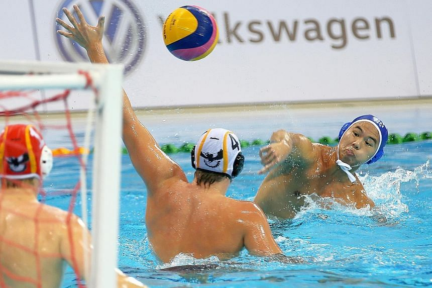 Singapore's Chiam Kunyang attempting to score against the Australian team during their 7-6 win in the third-place play-off last night.