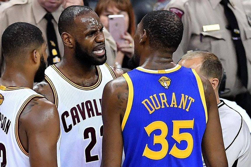Cleveland's LeBron James and Golden State's Kevin Durant squaring up after a foul in Game Four as tension mounted in the NBA Finals.