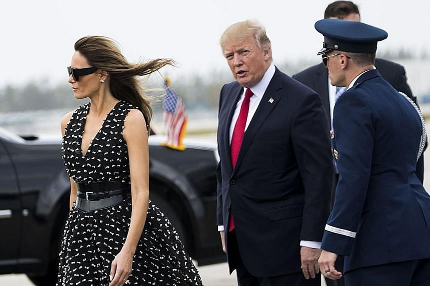 President Donald Trump and First Lady Melania Trump at Palm Beach International Airport in West Palm Beach, Florida, in April. The Politico news website reported that Mrs Trump and their young son Baron will be moving into the White House on Wednesda