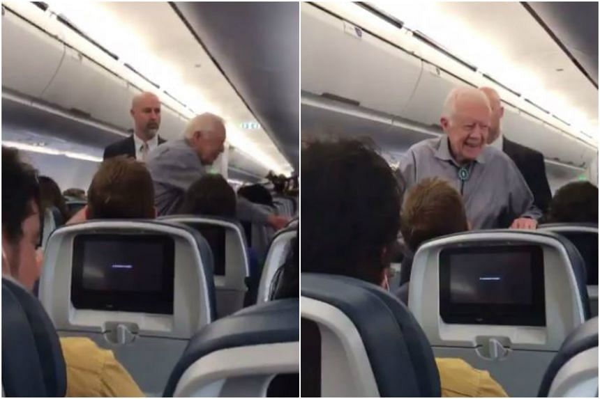 Former US president Jimmy Carter shaking the hand of every passenger onboard a Delta Airlines flight.